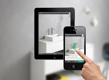 iPhone with the Hansgrohe app start screen